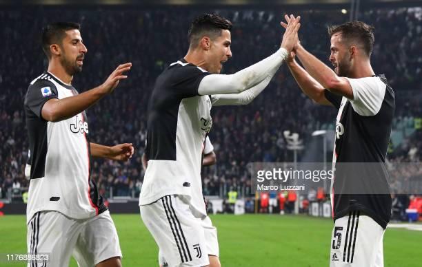 Miralem Pjanic of Juventus celebrates his goal with his teammates Sami Khedira and Cristiano Ronaldo during the Serie A match between Juventus and...