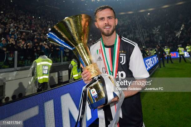 Miralem Pjanic of Juventus celebrates with the trophy after winning the Serie A Championship 20182019 at the end of the Serie A match between...