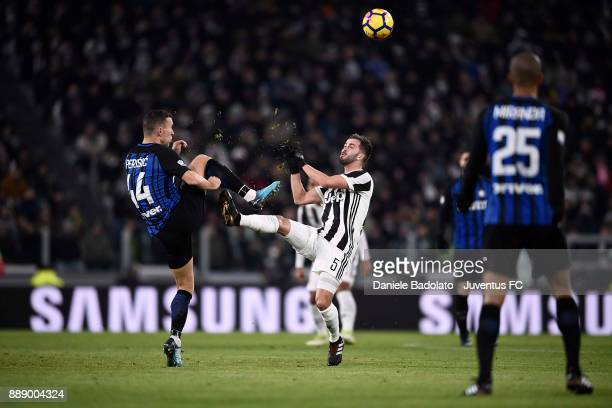 Miralem Pjanic of Juventus clashes with Ivan Perisic of FC Internazionale during the Serie A match between Juventus and FC Internazionale on December...