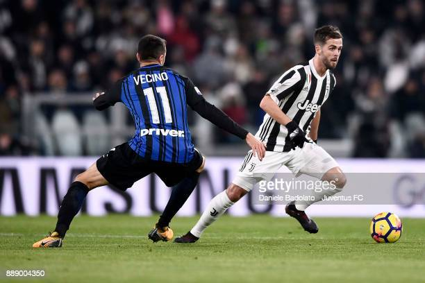 Miralem Pjanic of Juventus compete for the ball with Matias Vecino of FC Internazionale during the Serie A match between Juventus and FC...