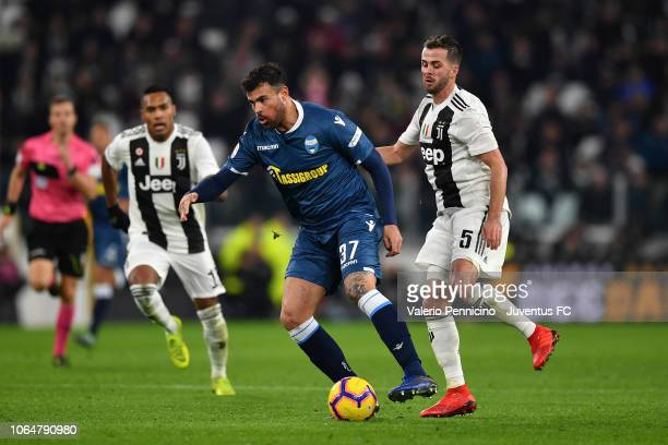 Miralem Pjanic of Juventus competes for the ball with Andrea Petagna of SPAL during the Serie A match between Juventus and SPAL at Allianz Stadium on...