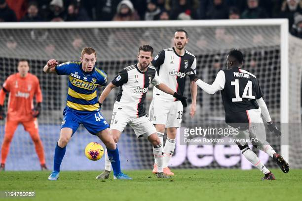 Miralem Pjanic of Juventus competes for the ball with Dejan Kulusevski scores the opening goal during the Serie A match between Juventus and Parma...
