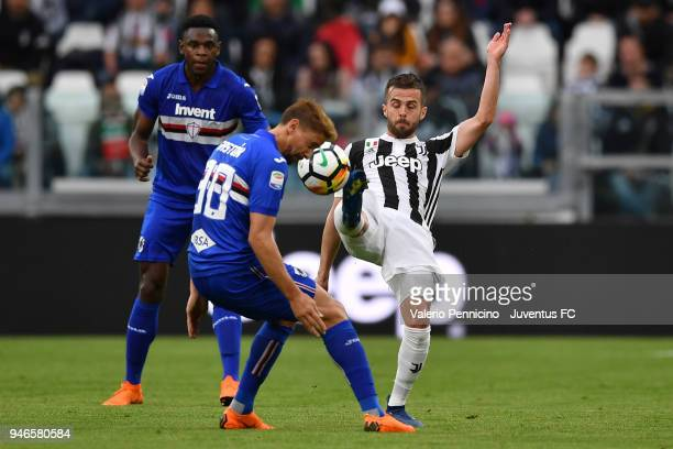 Miralem Pjanic of Juventus competes for the ball with Dennis Praet of UC Sampdoria during the serie A match between Juventus and UC Sampdoria at...