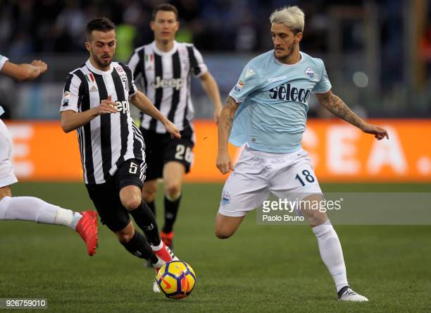 Miralem Pjanic of Juventus competes for the ball with Luis Alberto of SS Lazio during the serie A match between SS Lazio and Juventus at Stadio...