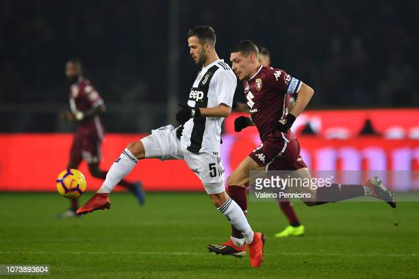 Miralem Pjanic of Juventus controls the ball against Andrea Belotti of Torino FC during the Serie A match between Torino FC and Juventus at Stadio...