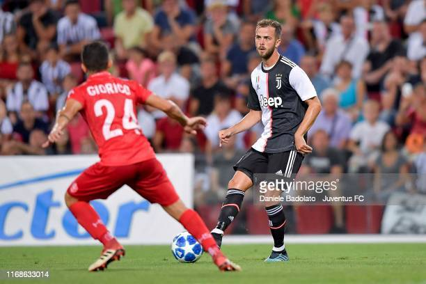 Miralem Pjanic of Juventus controls the ball during Triestina v Juventus pre season friendly match at Stadio Nereo Rocco on August 17 2019 in Trieste...