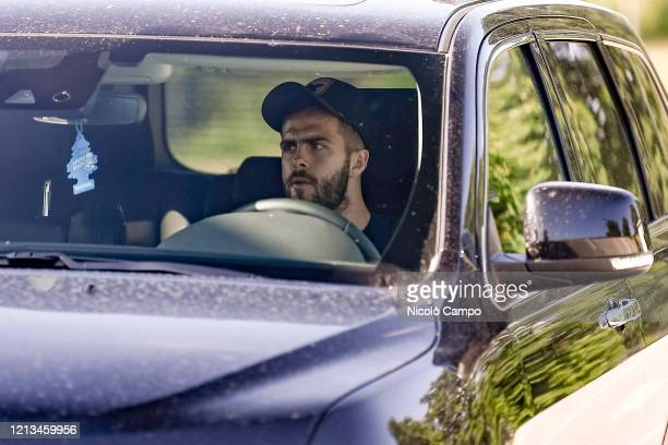 Miralem Pjanic of Juventus FC arrives by car to the Continassa training ground to attend a training session Serie A plans to resume its season on 13...