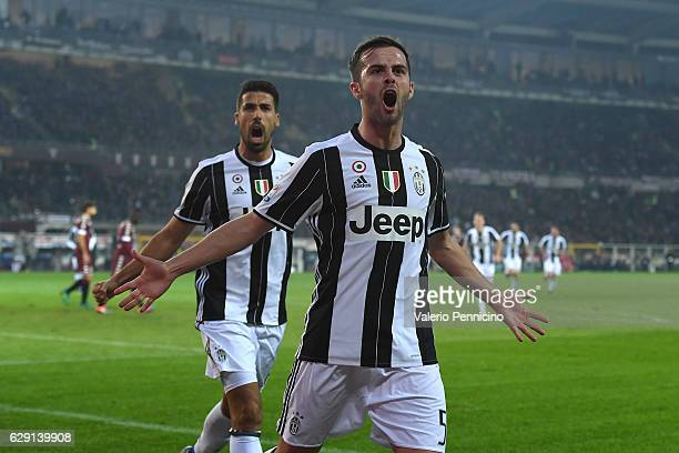 Miralem Pjanic of Juventus FC celebrates a goal with team mate Sami Khedira during the Serie A match between FC Torino and Juventus FC at Stadio...