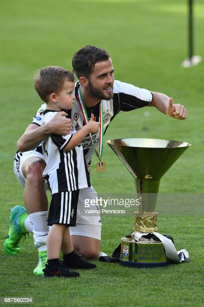 Miralem Pjanic of Juventus FC celebrates with the trophy after the beating FC Crotone 3-0 to win the Serie A Championships at the end of the Serie A...