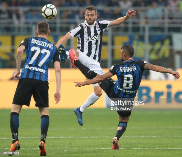 Miralem Pjanic of Juventus FC competes for the ball with Rafinha Alcantara of FC Internazionale Milano during the serie A match between FC...
