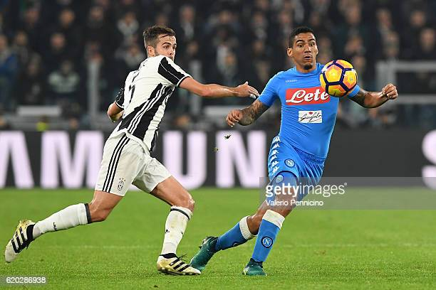 Miralem Pjanic of Juventus FC competes with Marques Loureiro Allan of SSC Napoli during the Serie A match between Juventus FC and SSC Napoli at...