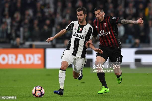 Miralem Pjanic of Juventus FC is challenged by Jose Sosa of AC Milan during the Serie A match between Juventus FC and AC Milan at Juventus Stadium on...