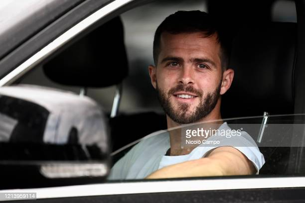 Miralem Pjanic of Juventus FC smiles as he arrives by car to the Continassa training ground to attend a training session Serie A plans to resume its...