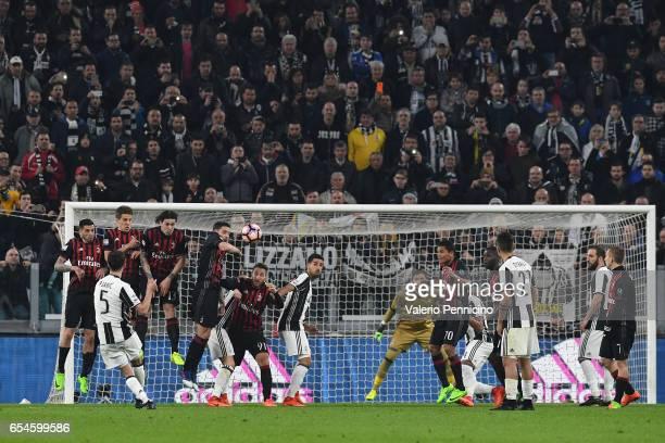 Miralem Pjanic of Juventus FC takes a free kick during the Serie A match between Juventus FC and AC Milan at Juventus Stadium on March 10 2017 in...