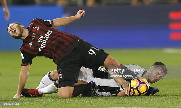 Miralem Pjanic of Juventus in action against Andrea Bertolacci of AC Milan during the Italian Super Cup final match between Juventus and AC Milan at...