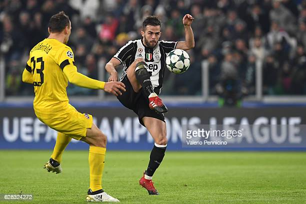 Miralem Pjanic of Juventus in action agaist Gordon Schildenfeld of GNK Dinamo Zagreb during the UEFA Champions League Group H match between Juventus...