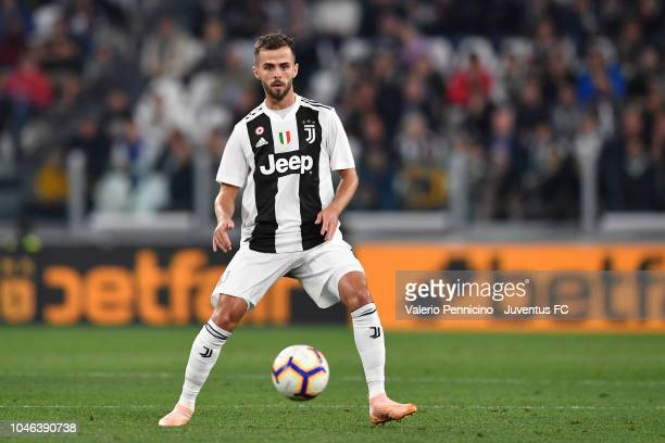 Miralem Pjanic of Juventus in action during the serie A match between Juventus and Bologna FC on September 26 2018 in Turin Italy