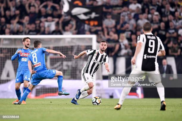 Miralem Pjanic of Juventus in action during the serie A match between Juventus and SSC Napoli on April 22 2018 in Turin Italy