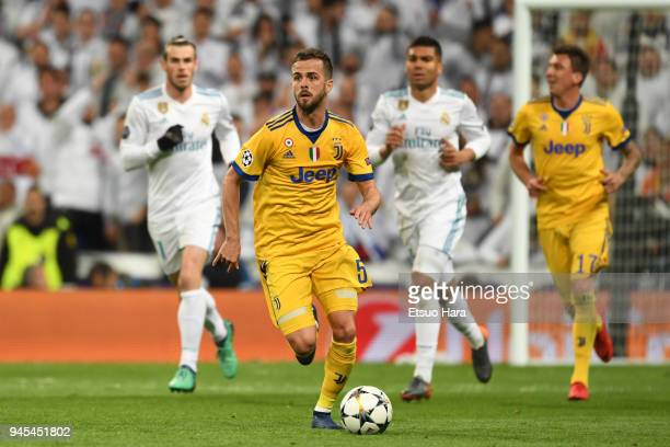 Miralem Pjanic of Juventus in action during the UEFA Champions League quarter final second leg match between Real Madrid and Juventus at Estadio...