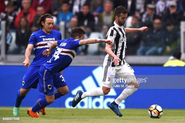 Miralem Pjanic of Juventus is Challanged by Lucas Torreira and Edgar Barreto of Sampdoria during the serie A match between Juventus and UC Sampdoria...
