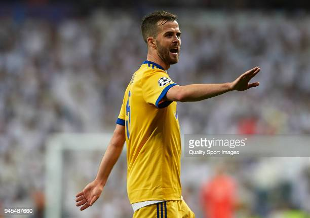 Miralem Pjanic of Juventus reacts during the UEFA Champions League Quarter Final Second Leg match between Real Madrid and Juventus at Estadio...