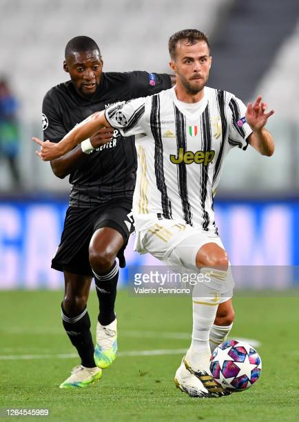 Miralem Pjanic of Juventus runs with the ball during the UEFA Champions League round of 16 second leg match between Juventus and Olympique Lyon at...