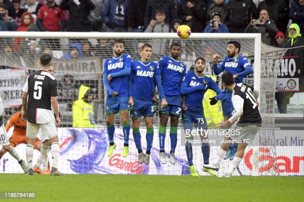 Miralem Pjanic of Juventus takes a free kick during the Serie A match between Juventus and US Sassuolo on December 1 2019 in Turin Italy