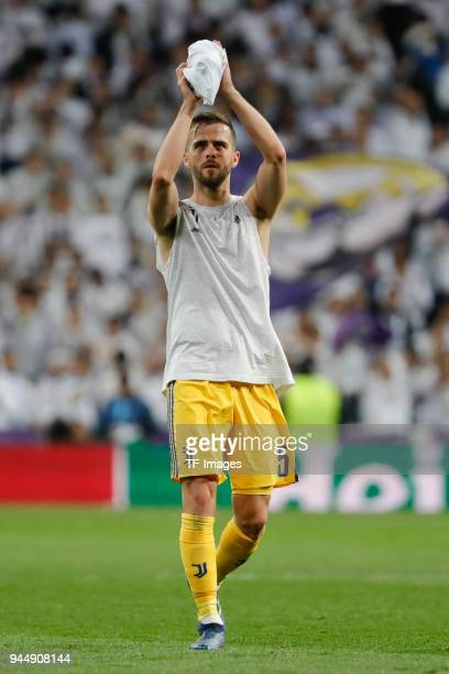 Miralem Pjanic of Juventus Turin looks dejected after the UEFA Champions League quarter final second leg match between Real Madrid and Juventus at...