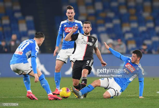 Miralem Pjanic of Juventus vies with Diego Demme of SSC Napoli during the Serie A match between SSC Napoli and Juventus at Stadio San Paolo on...