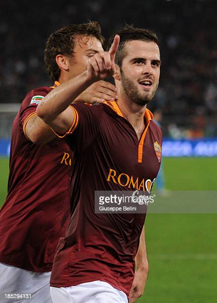 Miralem Pjanic of Roma celebrates after scoring his team's second goal from a penalty during the Serie A match between AS Roma and SSC Napoli at...