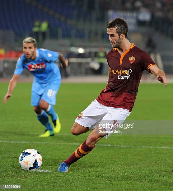 Miralem Pjanic of Roma kicks from the penalty spot to score his team's second goal during the Serie A match between AS Roma and SSC Napoli at Stadio...