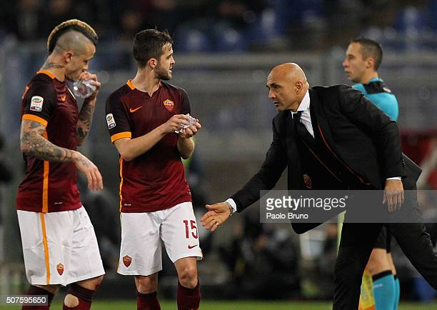 Miralem Pjanic with his head coach Luciano Spalletti of AS Roma celebrates after scoring the team's third goal during the Serie A match between AS...