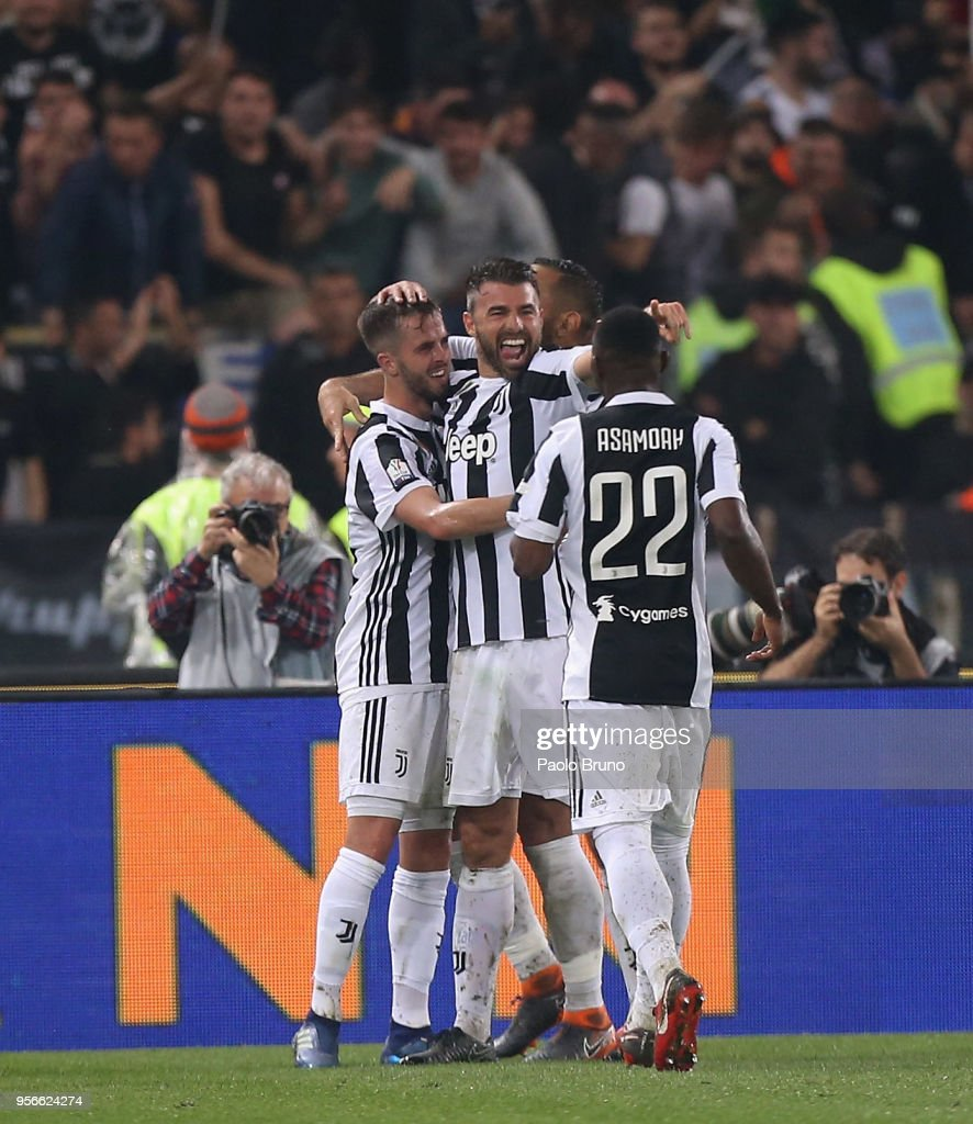 Miralem Pjanic with his teammates of Juventus celebrates after scoring the team's fourth goal during the TIM Cup Final between Juventus and AC Milan at Stadio Olimpico on May 9, 2018 in Rome, Italy.