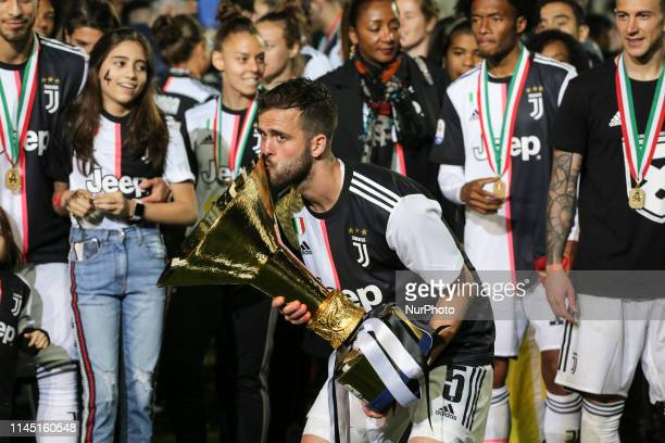 Miralem Pjanic with the trophy of Scudetto during the victory ceremony following the Italian Serie A last football match of the season Juventus...