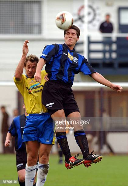 Miramar Ranges Tim Butterfield out jumps Central United's Stephen Callinan in the minor semi final of the Southern Trust National Soccer league at...