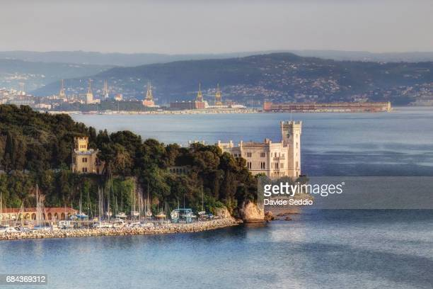miramare castle with trieste in the background - トリエステ ストックフォトと画像
