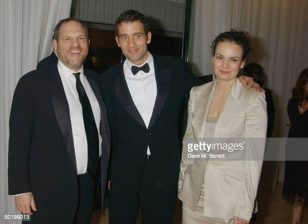 Miramax boss Harvey Weinstein with actors Clive Owen and wife SarahJane Fenton attend the Miramax aftershow party following the Orange British...