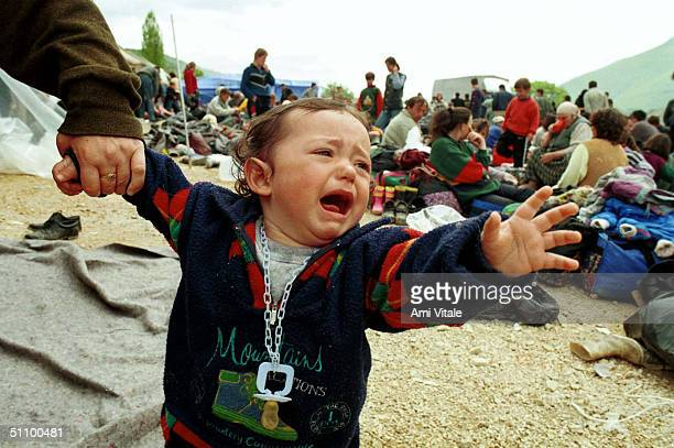 Miran Hyseni 15 Months An Ethnic Albanian Refugee From From Ferizai Cries Out While Waiting In The Transit Camp At The Blace Border Near Skopje...