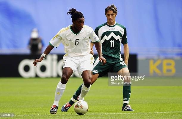 Miran Pavlin of Slovenia challenges MacBeth Sibaya of South Africa during the Group B match of the World Cup Group Stage played at the Daegu World...