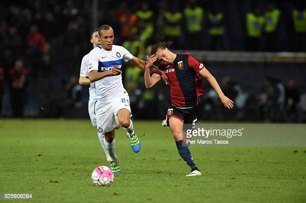 Mirand of FC Internazionale competes for the ball with Diego Laxalt of Genoa CFC during the Serie A match between Genoa CFC and FC Internazionale...