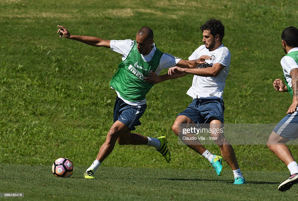 Miranda (L) and Andrea Ranocchia compete for the ball during the FC Internazionale training session at the club's training ground at Appiano Gentile on August 11, 2016 in Como, Italy.