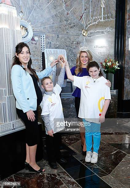 Miranda Bernard Miss America 2013 Mallory Hagan and Bryce and Molly of the Childrends Miracle Network Hospitals light The Empire State Building on...