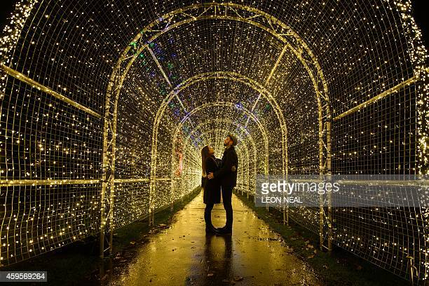 Miranda Jenatka and Alex Little pose for photographs during the launch event of the 'Christmas at Kew' lights in Kew Gardens in southwest London on...