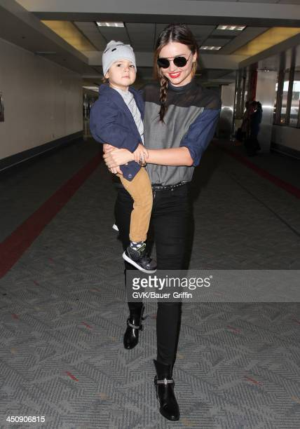 Miranda Kerr and baby Flynn Christopher Bloom are seen arriving at LAX airport on November 20 2013 in Los Angeles California
