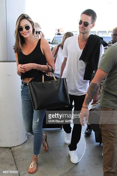 Miranda Kerr and Evan Spiegel are seen at LAX on August 12 2015 in Los Angeles California