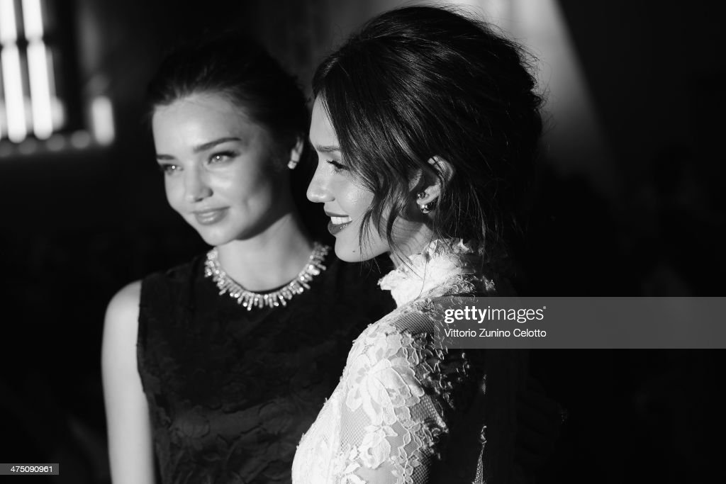Miranda Kerr and Jessica Alba attend the H&M show as part of the Paris Fashion Week Womenswear Fall/Winter 2014-2015 at Le Grand Palais on February 26, 2014 in Paris, France.