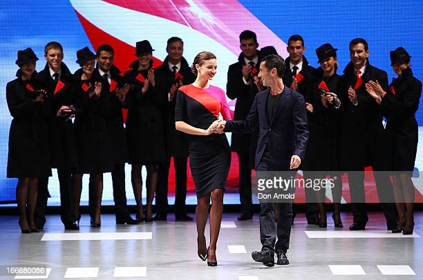 Miranda Kerr and Martin Grant pose alongside Qantas staff during the Qantas uniform unveiling at Hordern Pavilion on April 16 2013 in Sydney Australia