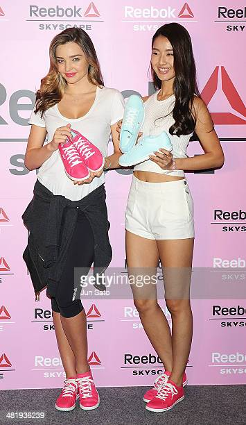 Miranda Kerr and model Sumire attend the press conference to promote Reebok Skyscape on April 2 2014 in Tokyo Japan