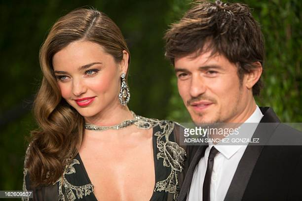 Miranda Kerr and Orlando Bloom arrive for the 2013 Vanity Fair Oscar Party on February 24 2013 in Hollywood California AFP PHOTO/ADRIAN...