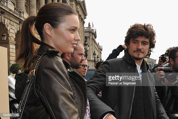 Miranda Kerr and Orlando Bloom depart from the Balenciaga Ready to Wear Spring/Summer 2011 show during Paris Fashion Week on September 30 2010 in...
